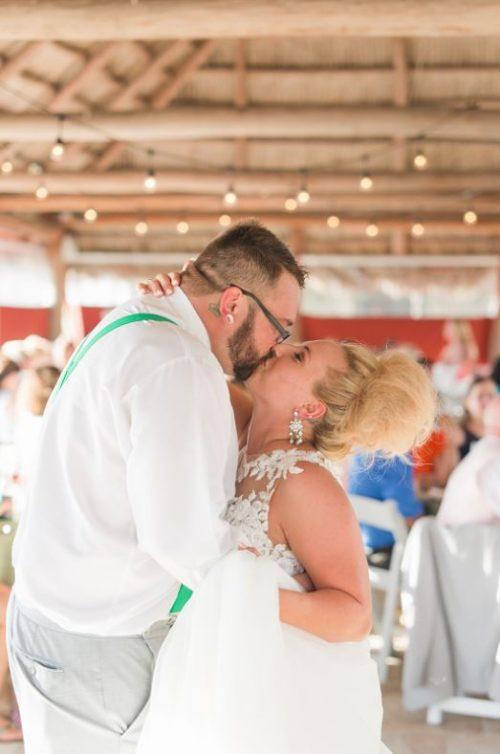 Couple kissing under the tiki