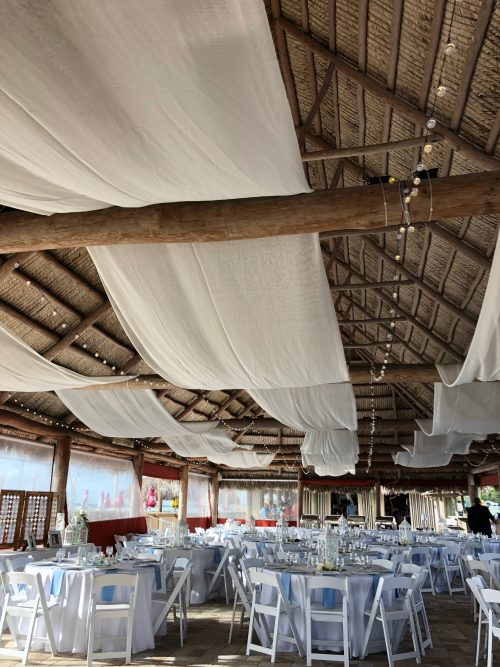 reception with white cloth banners on ceiling